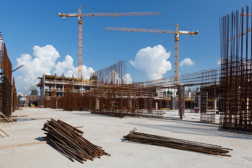34110579 - construction site with cranes on sky background