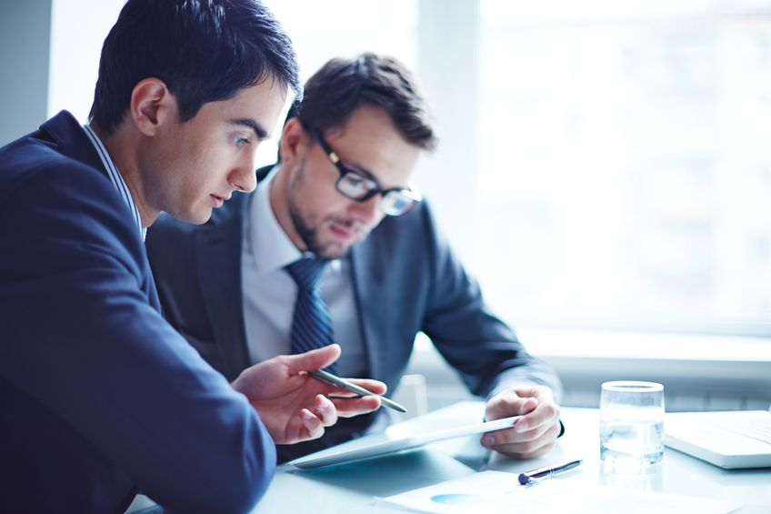 37942605 - serious businessman explaining data to his colleague at meeting